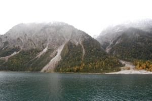 A line of mountains and an Alpine lake on the Austrian/German border